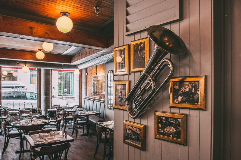 Saxophone and pictures on the wall in Modavie restaurant